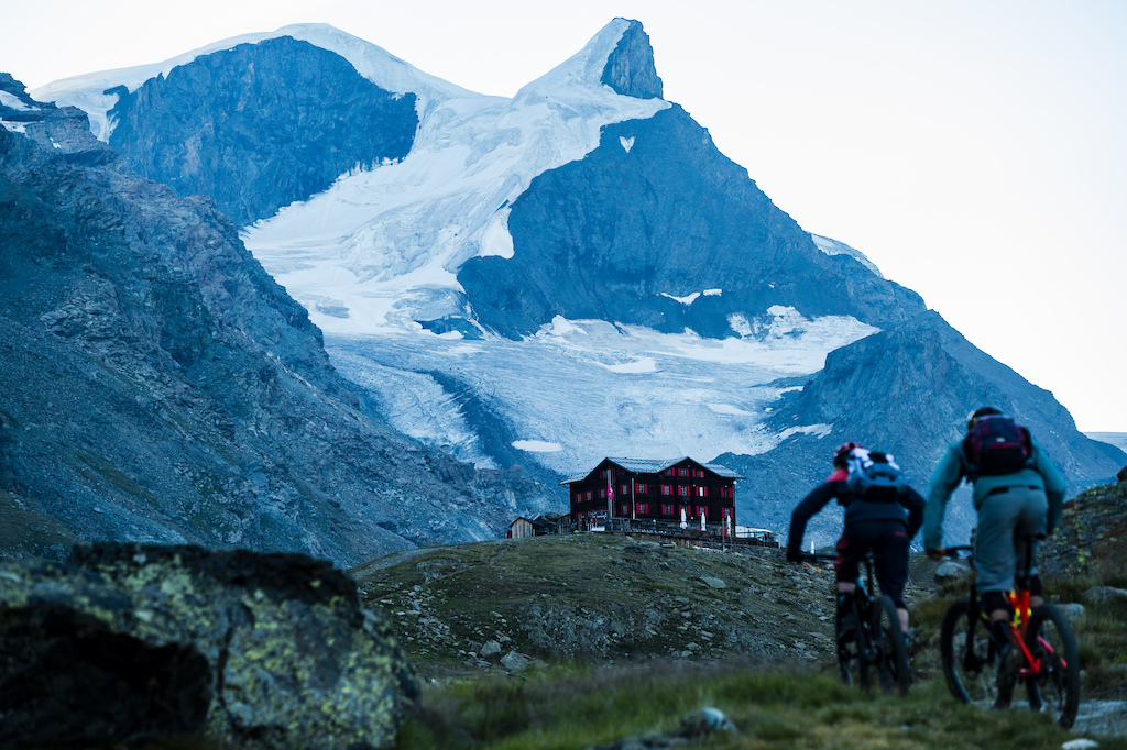 Julia Hofmann and Stephen Matthews riding near Fluhalp Hut 2620 meters above sea level above Zermatt Switzerland. Photo Mattias Fredriksson.