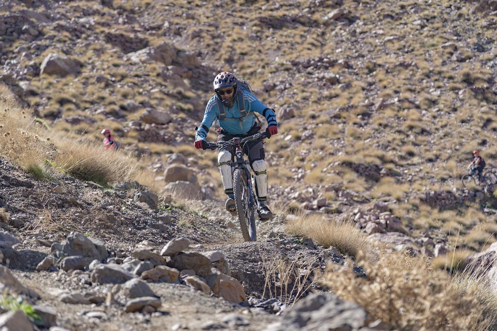 Rider Altaf Abbas dodging loose stones