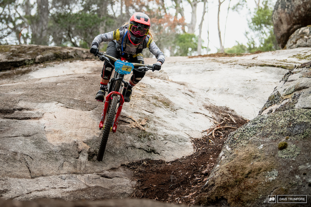 Series leader Isabeau Courdurier on one of the many many rock slabs found out on track in Tasmania.