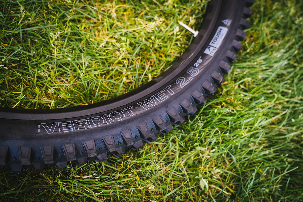 "WTB Verdict Wet: Just released after a full year of race and trail testing, the Verdict Wet was developed to be the end all of mud spikes for no compromise enduro and gravity racing. Three compounds are used to prop up the tall knobs, while ensuring maximum traction at the contact points. ""The Verdict Wet is available in a single TCS Tough/High Grip level to provide a stout, supportive foundation that prevents any unwanted flex or squirm often experienced with other spikes.""  It's a 2.5"" casing, available in 29"" and 27.5"" sizes."