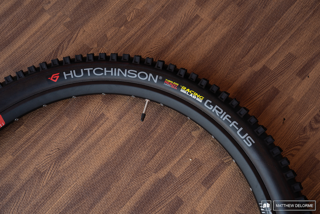 """Hutchinson Griffus: Hutchinson is claimed to be the inventor of the pneumatic cycling tire. The Griffus is their enduro racing tire and it has done well in EWS competition. Available for 27.5"""" and 29"""" wheels in 2.4"""" and 2.5"""" widths, with the 2.5"""" option receiving a taller, more aggressive tread pattern. Hutchinson suggests running the 2.5"""" version up front, and the 2.4"""" in the back."""