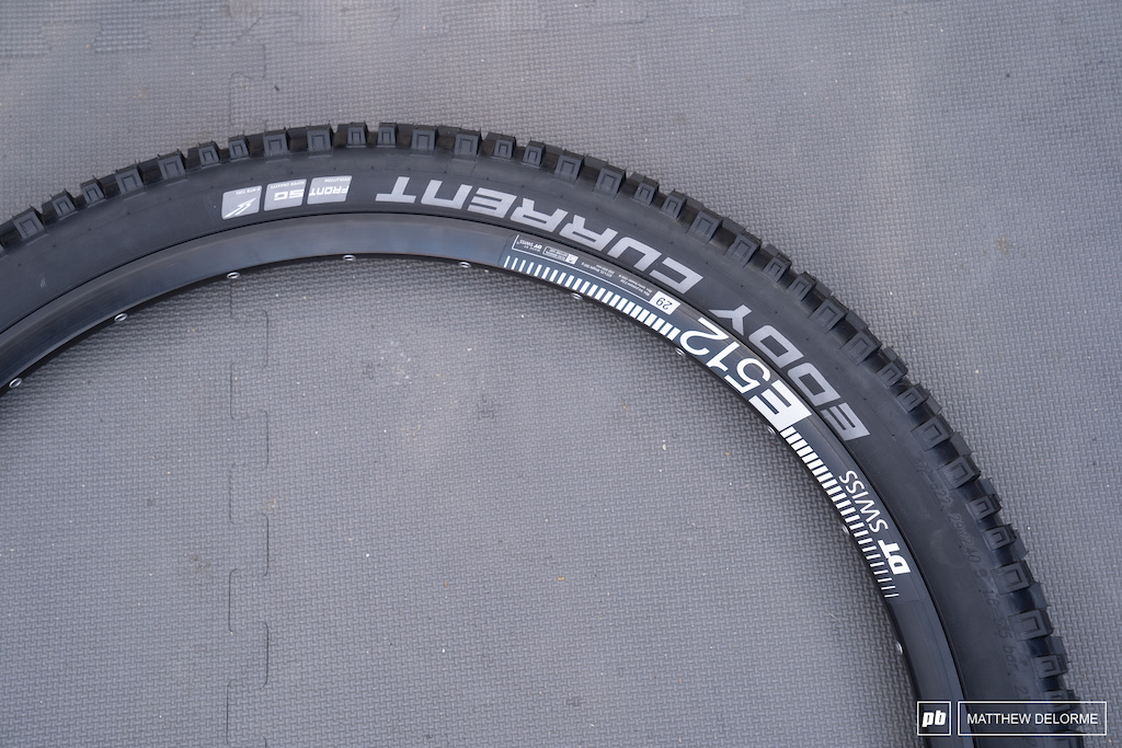 Schwalbe Eddy Current: Originally designed as an e-bike tire, this ultra reinforced front/rear combination has been embraced by aggressive riders who destroy wheels on a regular basis. Eddy Currents are sold in the grey, tough wearing compound, but this is the front specific tire with the soft-compound Supergravity DH casing and rubber.