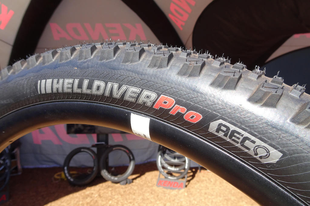 Kenda Helldiver Pro: Kenda is back on point with a competitive range of enduro and gravity tires. The Helldiver is their fast-rolling hard-condition flat-top design. This one uses their AEC (Advanced Enduro Casing), which has three nylon bands: two on the sidewalls and a finely woven anti-puncture band under the tread.