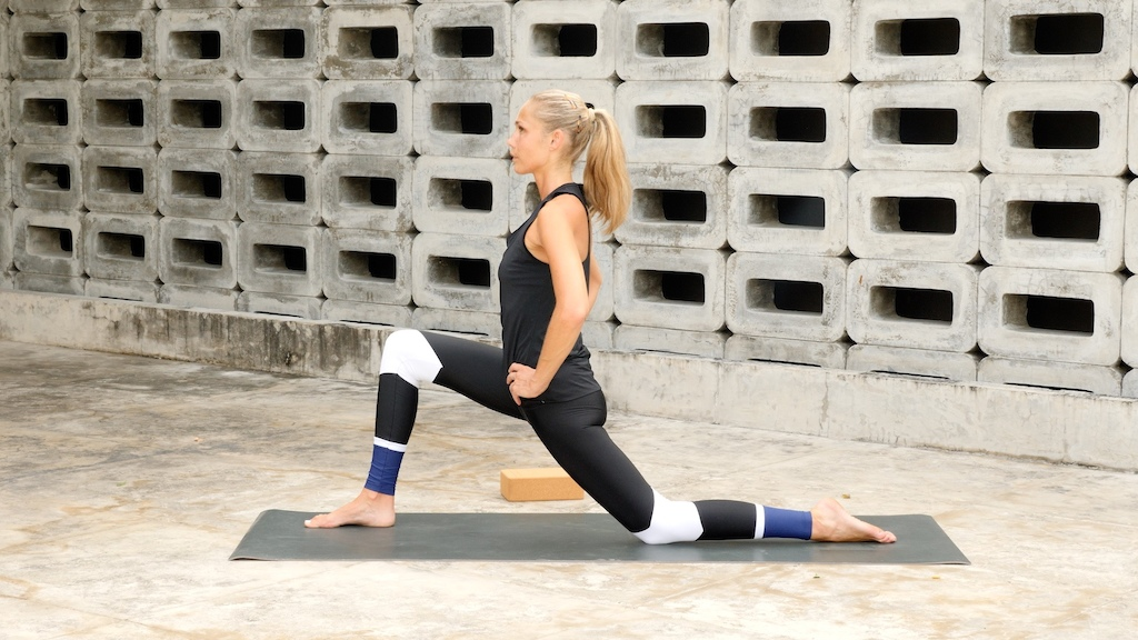 Low Lunge opens up the hip flexors which allows the glutes hamstrings and lower back muscles to fire more efficiently.