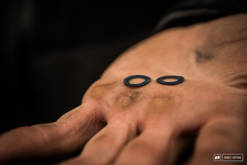 Callused hands and a pair of delicate washers. Mechanics perform magic every race week to keep things afloat.