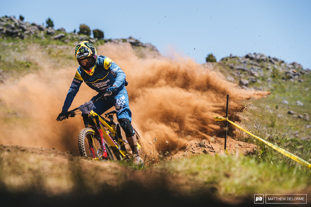Race run berm explosions from Sam Hill We think he even had a grin on his face when he rode past.