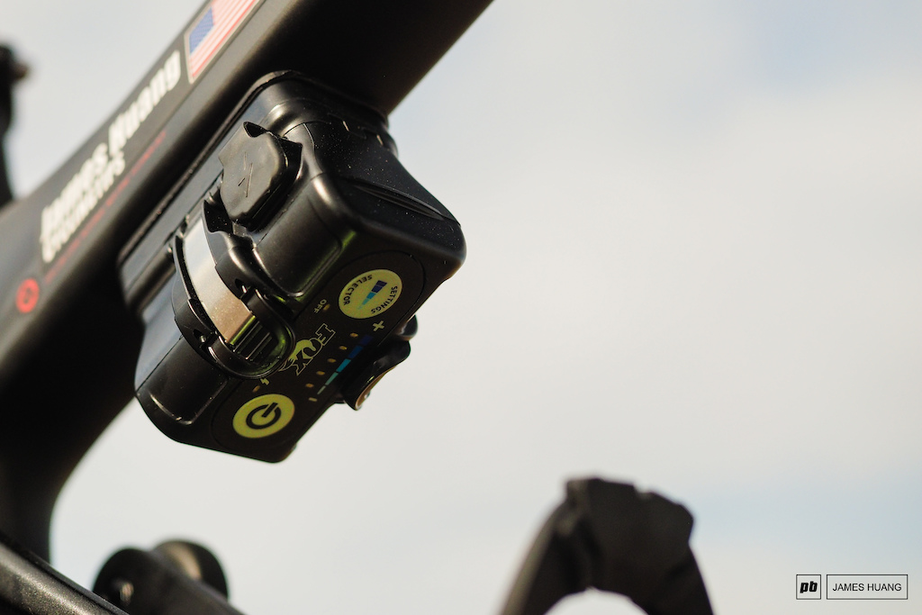 Pivot tucks the Live Valve controller and battery underneath the top tube where the buttons are still readily accessible but the flashing lights aren t right in the rider s field of view.