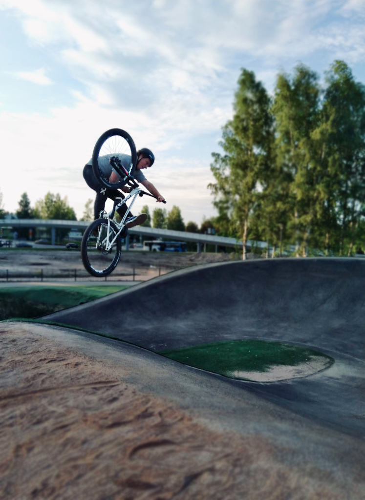 No better way to misuse a bmx racing track than popping tricks out of the slanted walls of the bumps.