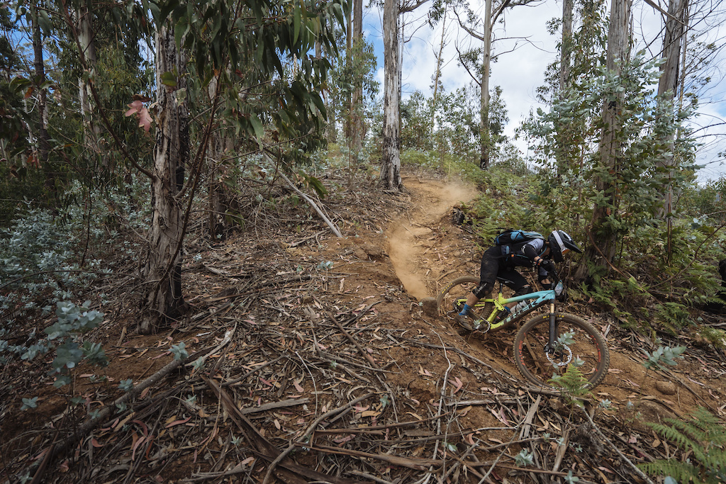 Noga Korem s coach Nathalie Schneitter chasing her down the trail.