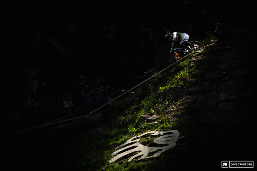 Loic Bruni through a sliver of light coign does into the finish area.