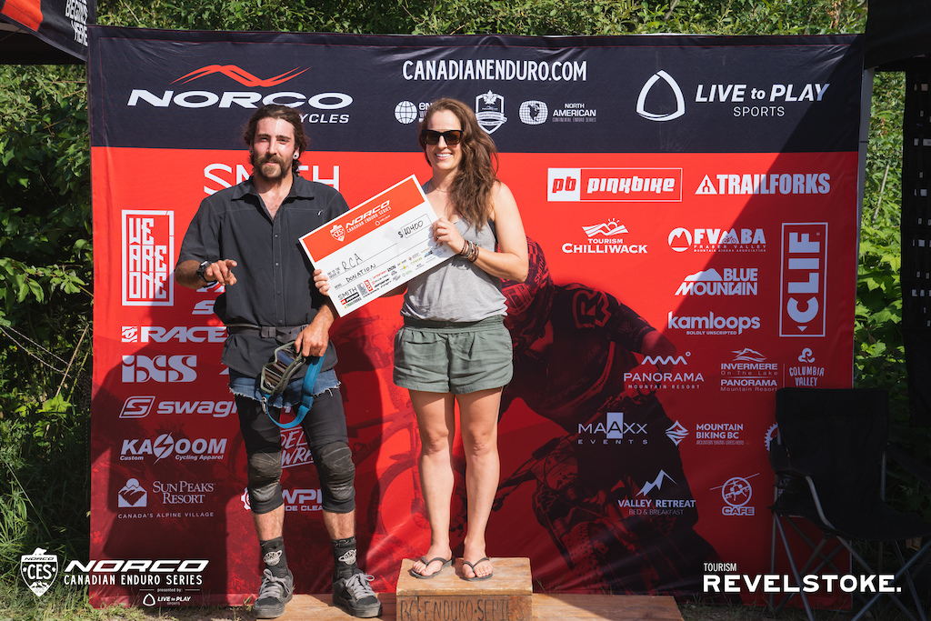 Revelstoke Cycling Association Representatives Meghan Tabor president and trail builder shredder racer Katlyn Davies accepting a cheque for 10400 from the Canadian National Enduro Series.