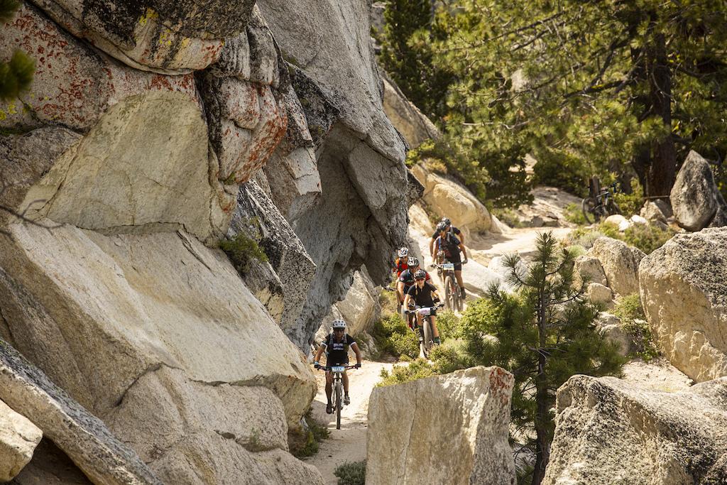 Riders making their way along the Marlette Flume trail riding beneath towering slabs of granite.