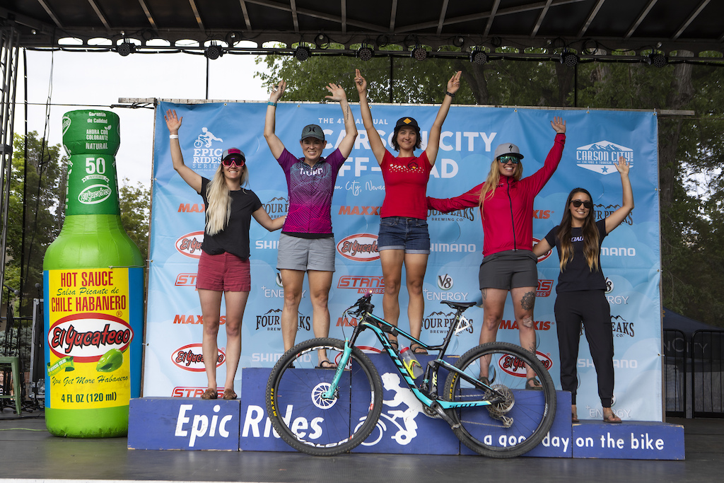 Top amateur women take the main stage podium after a hard day in the saddle.