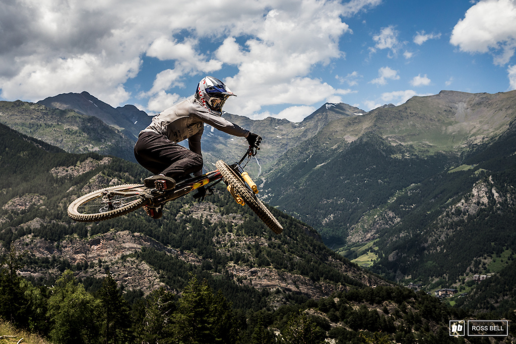 Finn Iles laying it flat in front of the the Andorran mountains.