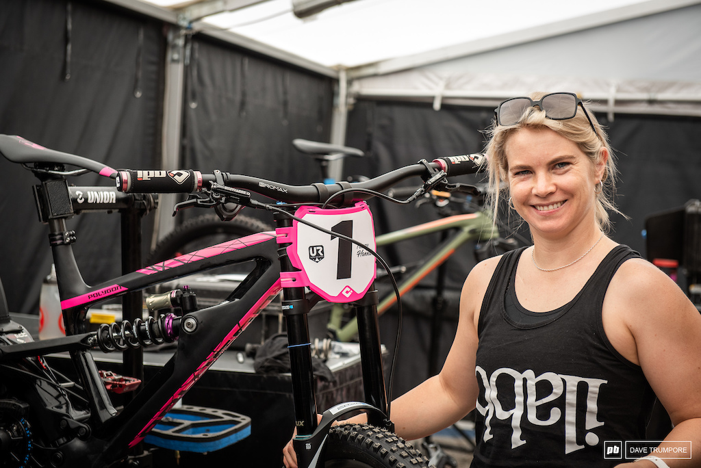Tracey Hannah all smiles with the number one plate on the front of her bike.
