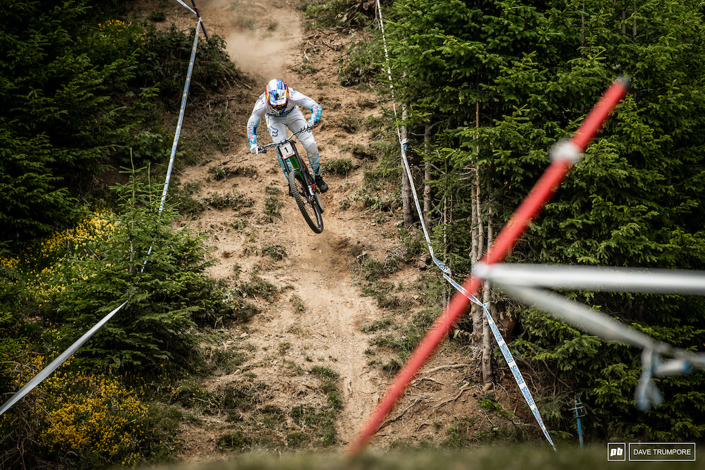 Full commitment and no brakes down this steep chute for Loic Bruni