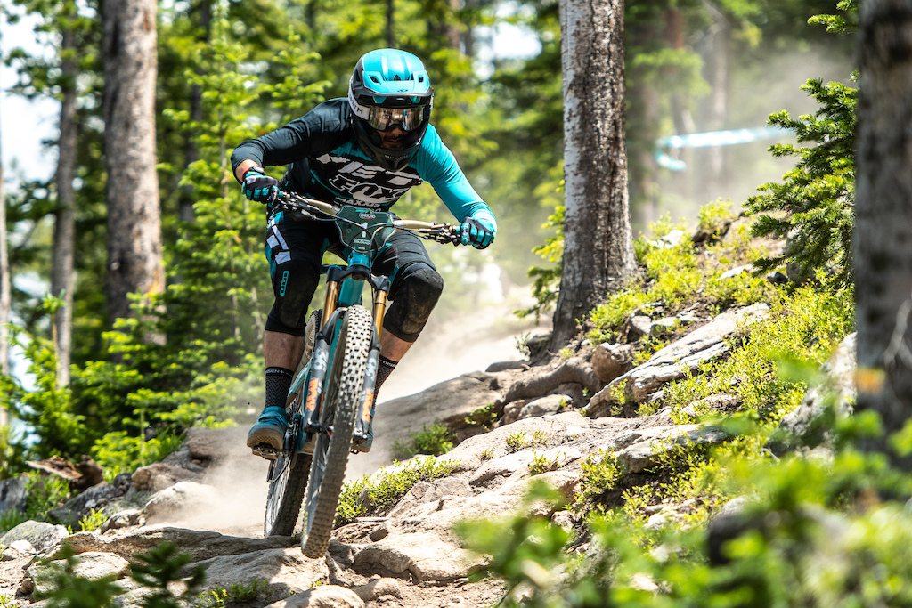 Shawn Neer giving it the gas on the Trestle Dh trail.