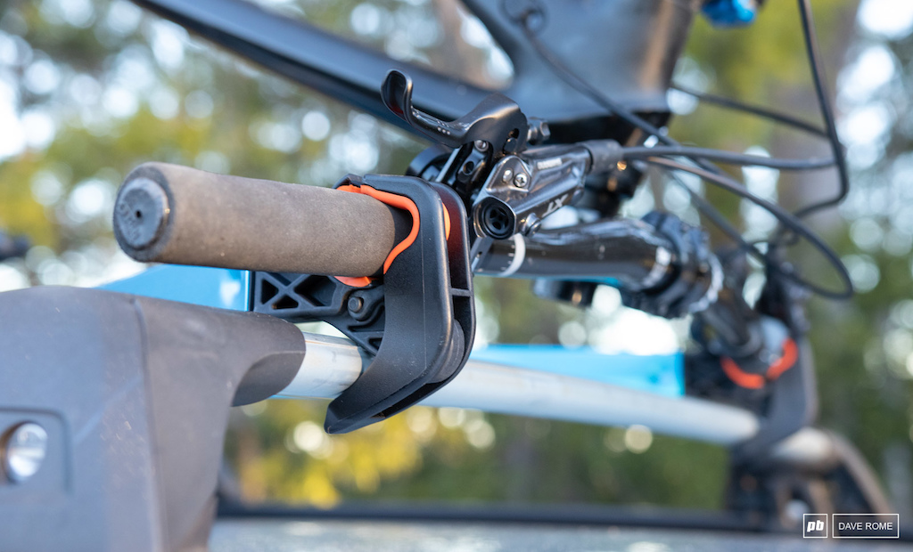 It s the crossbars that provide the Upside with clearance for brake levers and similar.