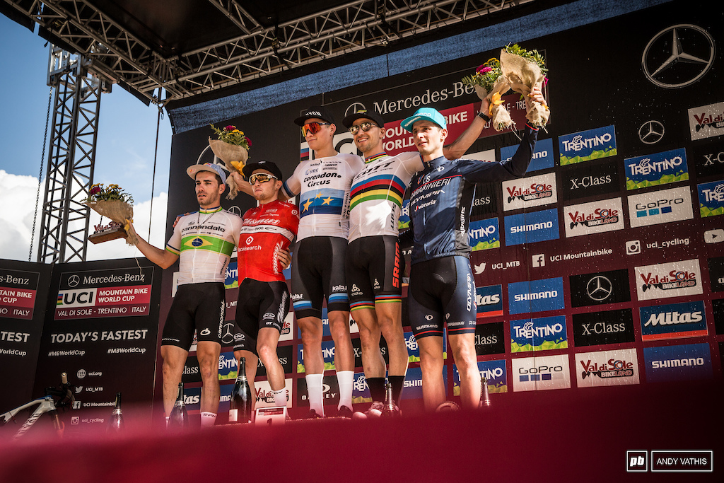 Elite Men's podium. Mathieu Van Der Poel, Mathias Flueckiger, Nino Schurter, Henrique Avancini, and Lucas Braidot.