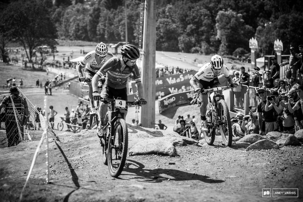 Flueckiger taking a quick peak over his shoulder as Schurter and Van Der Poel close in on him.