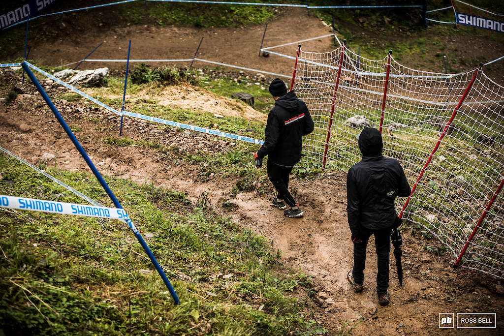 Neko Mulally and Jack Moir attempt to keep it rubber side down a section of slick mud up top.