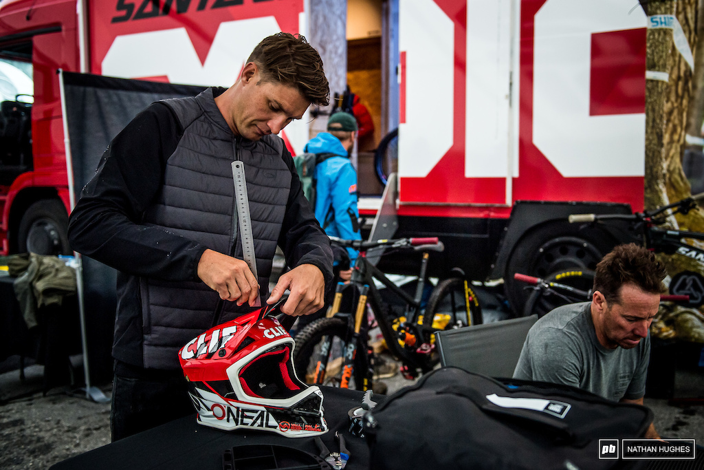 Greg Minnaar is either extremely fussy about his visor position or all the screwdrivers were out of reach... Well maybe that's his cover story.