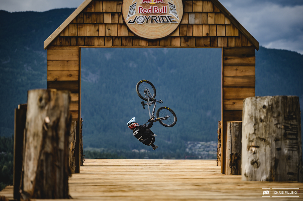 Back flip tail whip off the drop for Rheeder.