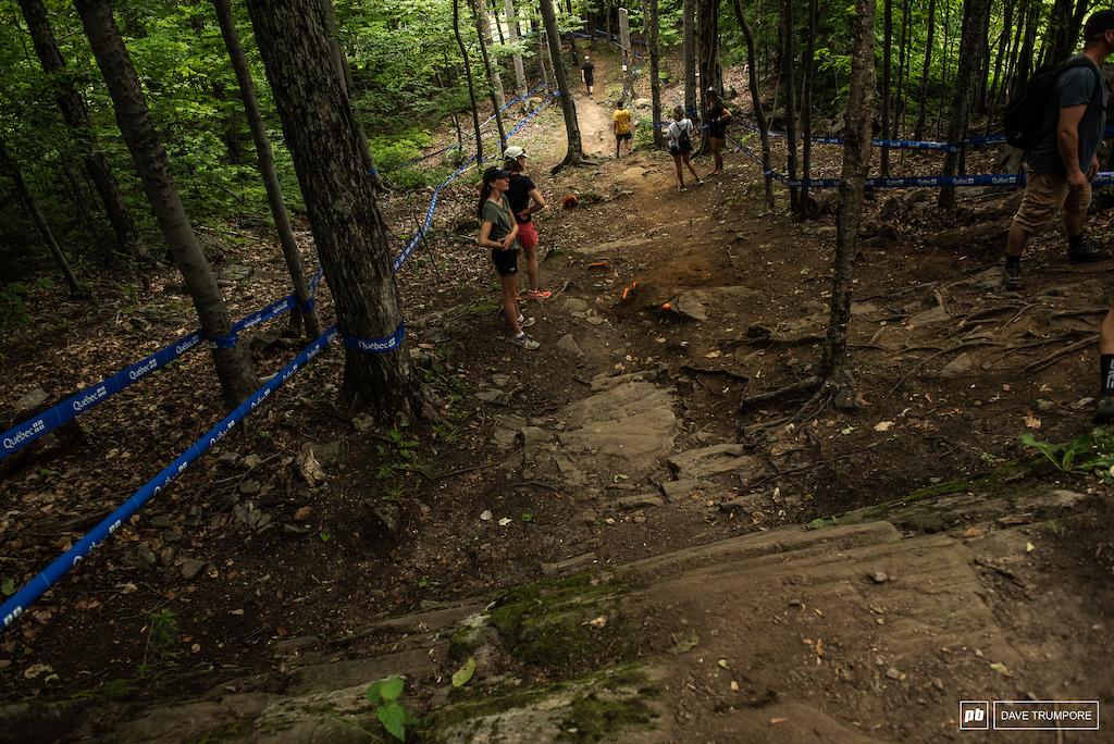 The big gap Greg Minnaar pioneered a few years back. The landing is just past their feet  and the rocks painted orange