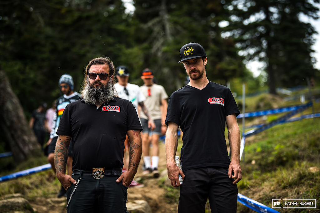 David Trummer and mechanic, Jensen, walking the upper slopes. David apparently can't explain his consistently incredible results this year... he's just riding 'normally'. Go figure.