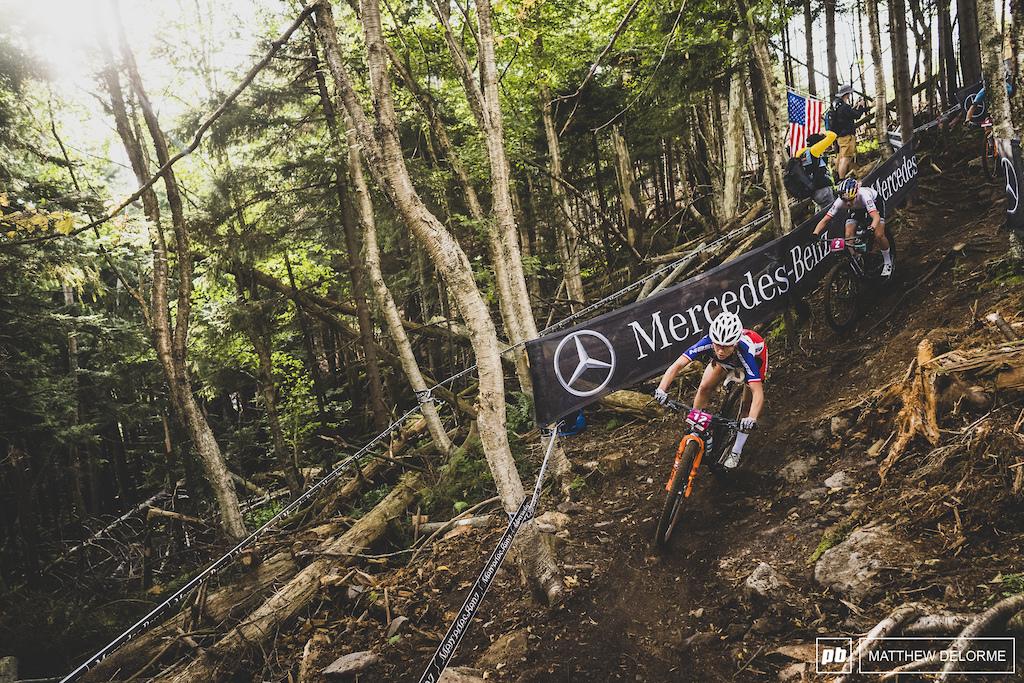 Loana Lecomte rides the fresh cut to third place.