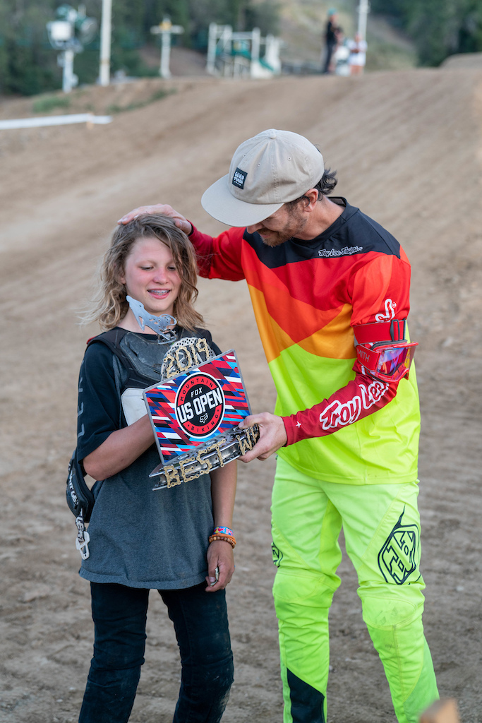 """Allan Cooke gives Finley Kirschenmann the Elite Whip Off Best Whip Trophy and says, """"I will see you in Whistler next year... I will be following you(Finley)."""""""