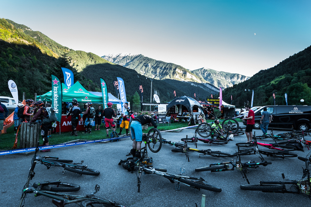 The race village at the end of the day. Bikes dumped and beers being ordered. Photo by Juanjo Otazu de indomitvisual