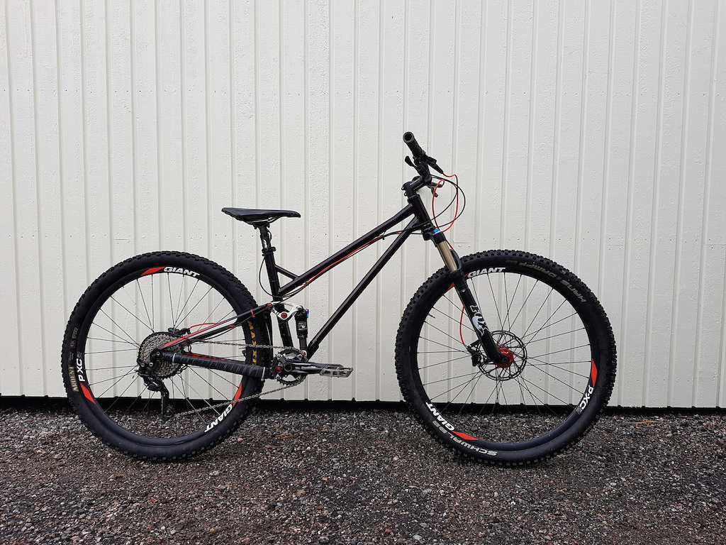 My kids new bike 29 er. Giant Anthem 2011 with new front triangle.