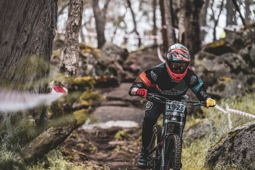 Lachie Forbes exiting rock section at Barjarg Downhill track at Victorian Downhill Series