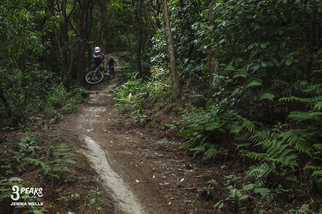 A rider looks to enjoy dropping into the final decent of Magnatron on the final stage of the Emerson s 3 Peaks Enduro.