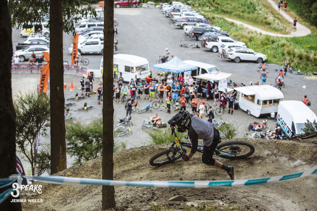 A rider enters the final tight berms before heading to the finish of the Emerson s 3 Peaks Enduro.