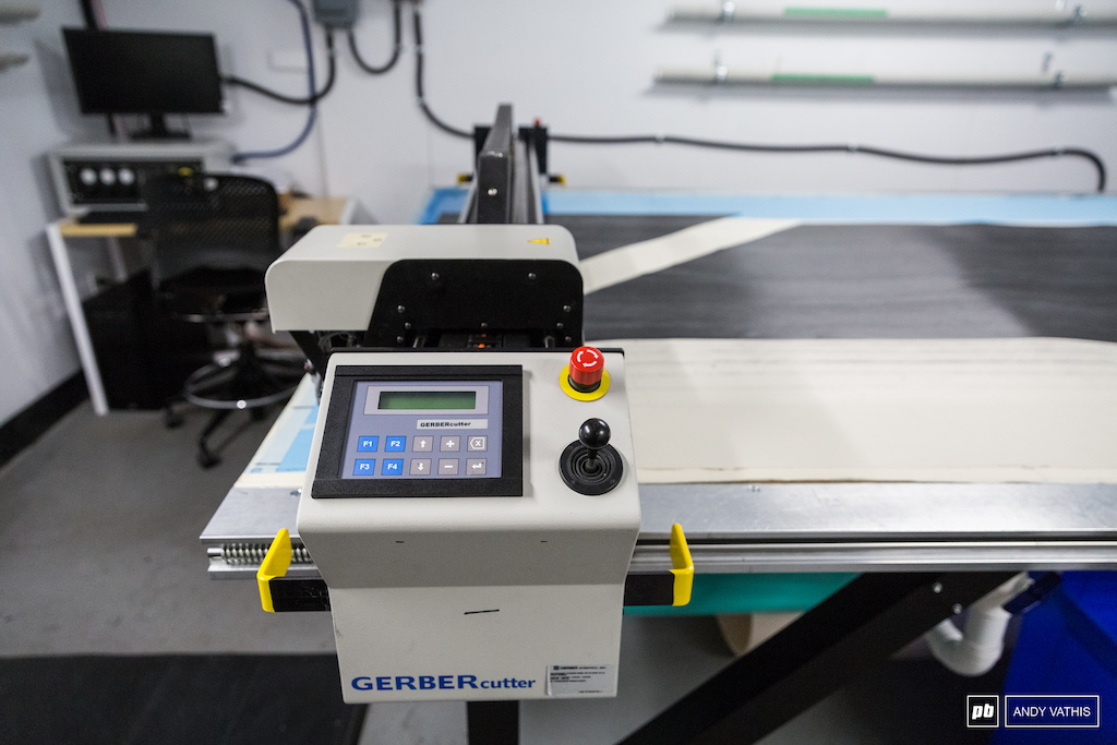 The machine that cuts and slices all the sheets of carbon to size.