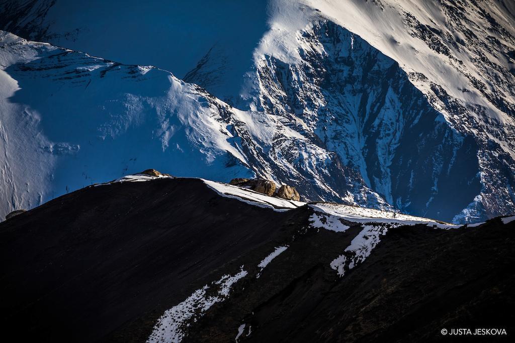 Tiny rider giant landscape.