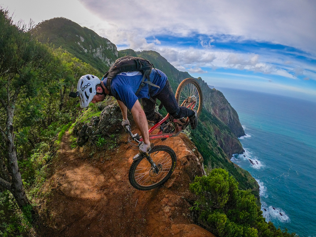 Nose wheelie on the edge of the cliff! Ross McArthur pulling a fine endo turn and swinging the rear over the infamous 'Boca Do Risco' cliff in Madeira, Dec 2019.