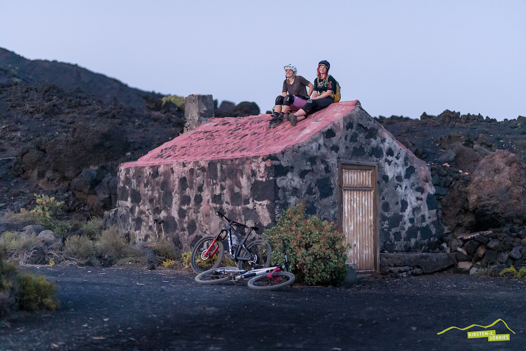 Like chickens on the roost. Angie and Kathi enjoy the last bit of sun after a good day riding in the most southern area of La Palma El Faro