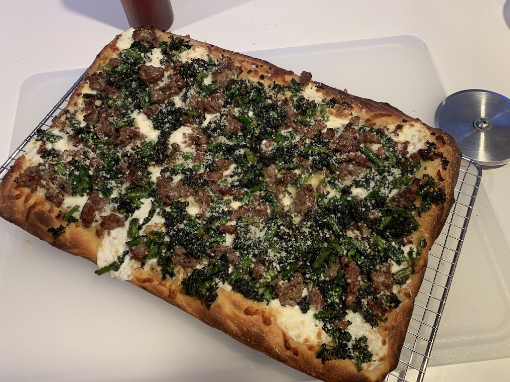 Charred broccolini mild sausage mozzarella percorino Roman style