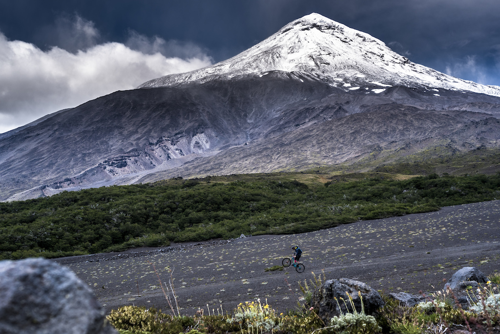 Matt Hunter dwarfed by the mighty Lanin Volcano on the Argentina-Chile border. This began a 3-day 100 Km long trail ride to Pucon Chile in February 2017.