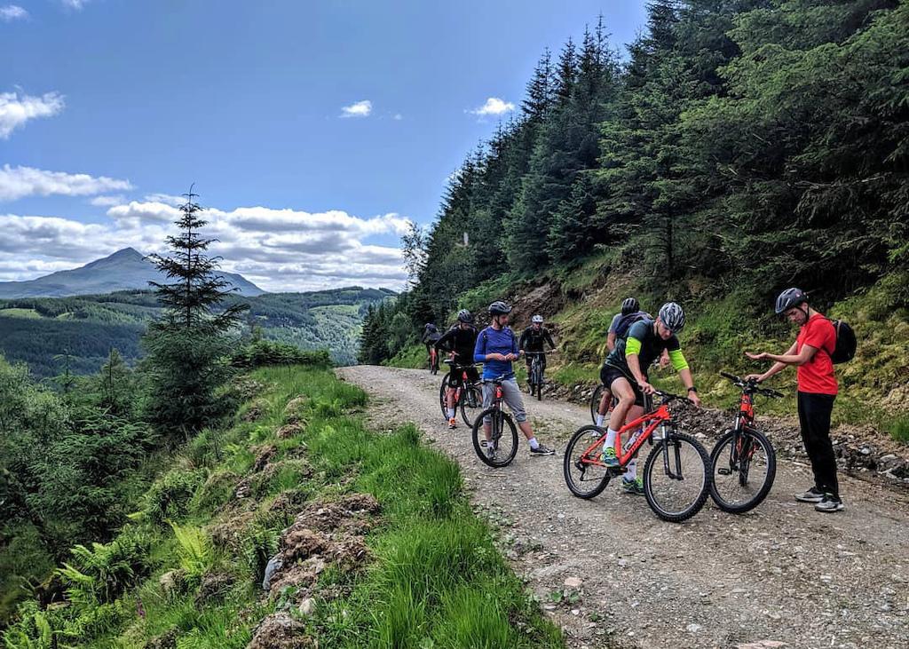 Guiding a group on the Glen Loin Loop near Arrochar on a beautiful sunny day.
