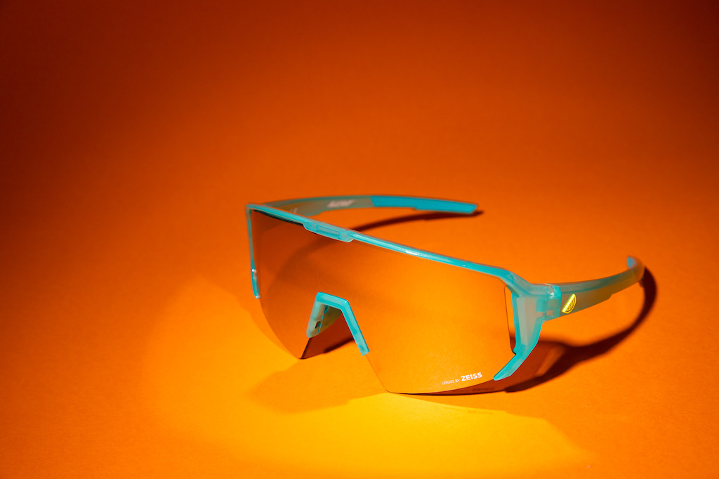 Melon Alleycat in turquoise with neon yellow icon and silver Zeiss lens