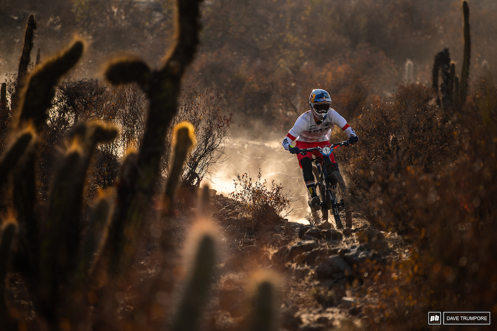Pedro Burns through the dust loose rocks and cactus