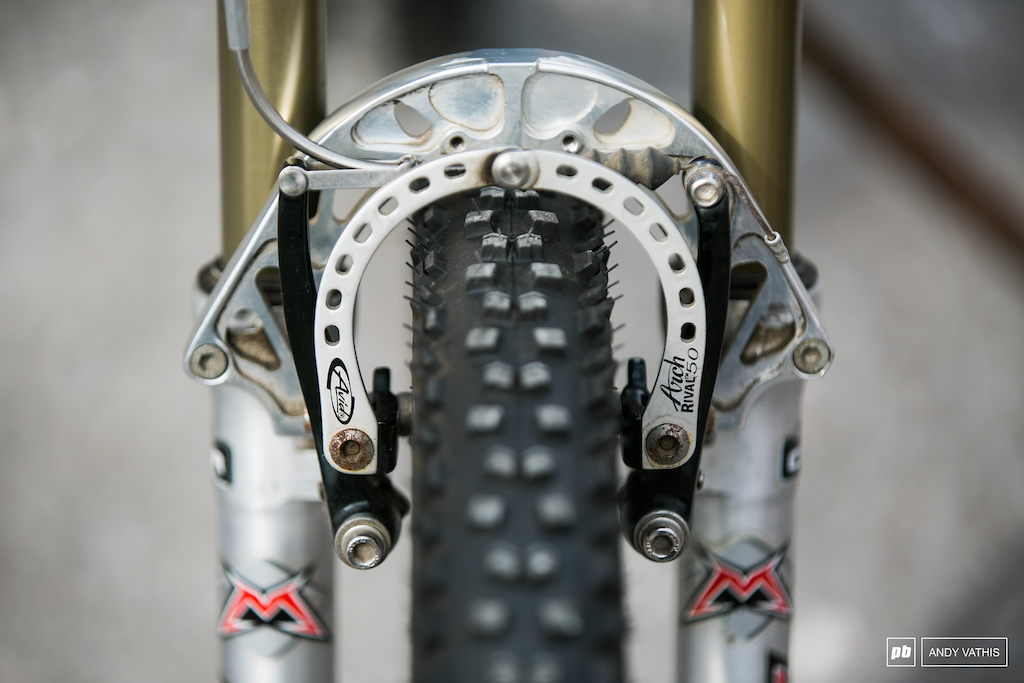 Avid Arch Rival 50 Brake Arches for the ultimate V-brake experience minus the Magura hydrolics . Apparently these had more modulation that the disc brakes offered at the time.