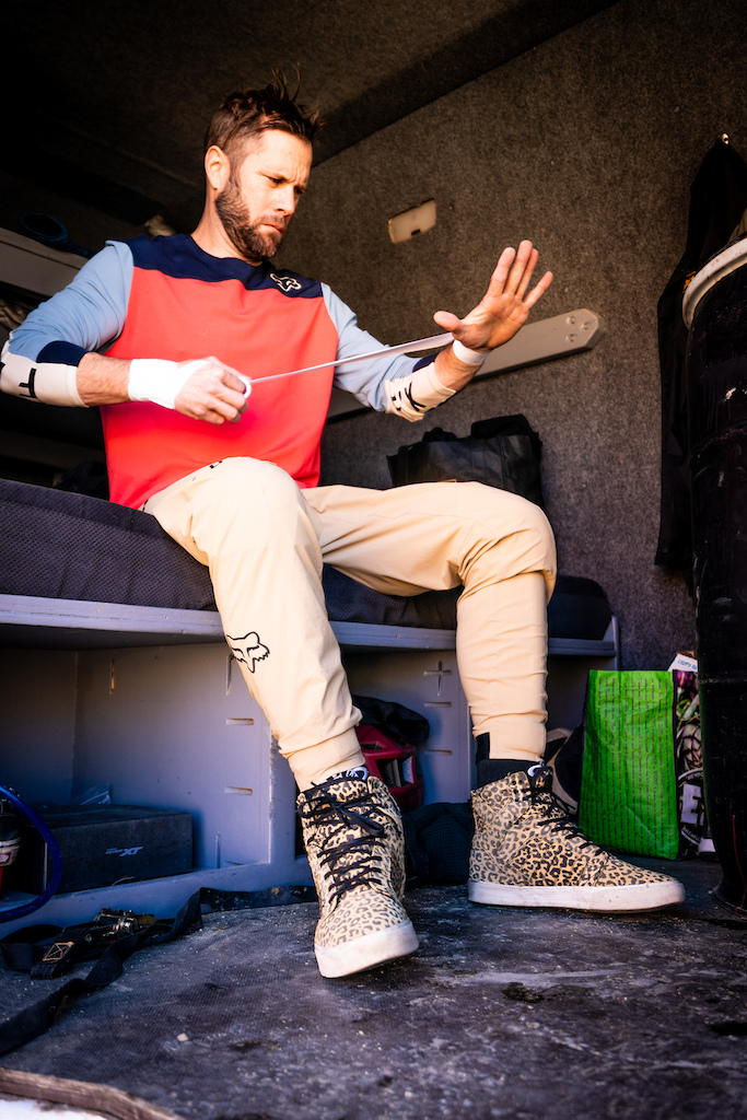 Kirt Voreis tapes his wrists before riding his mountain bike.