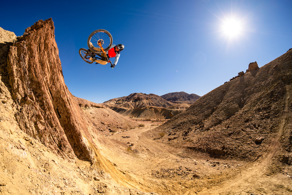 Kirt Voreis launches a lofty table in the California desert on his mountain bike.