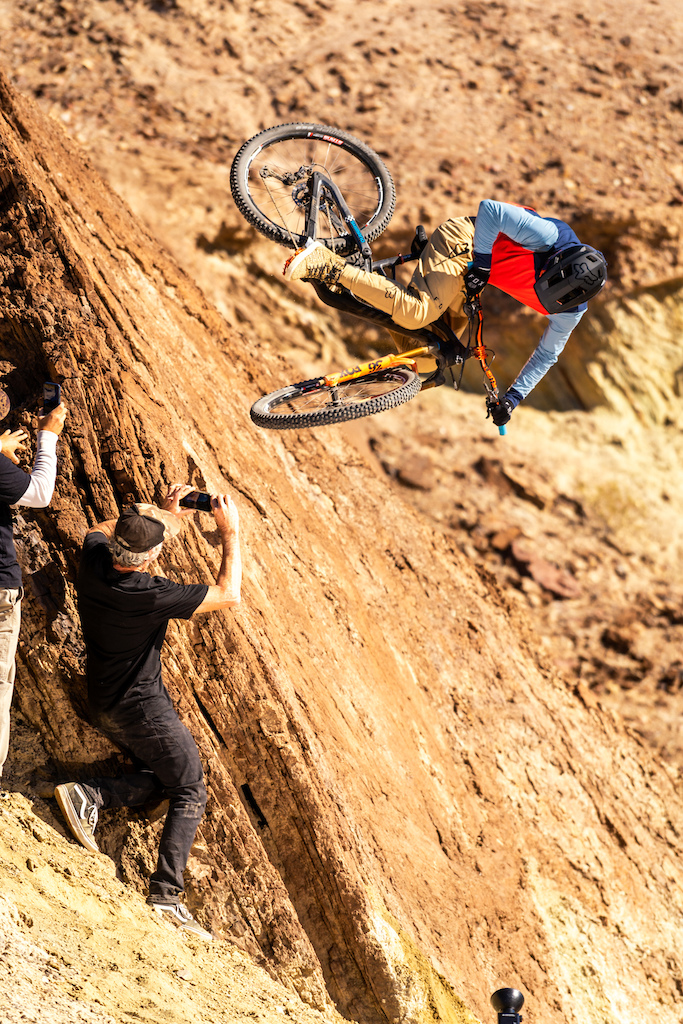 Kirt Voreis launches table in the California desert while Matt Collins and Danny Silva film him.