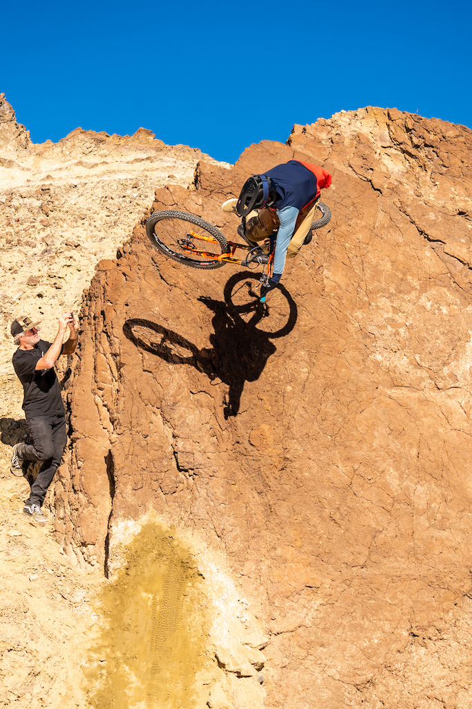 Kirt Voreis launches table in the California desert while Matt Collins and Danny Silva film him.